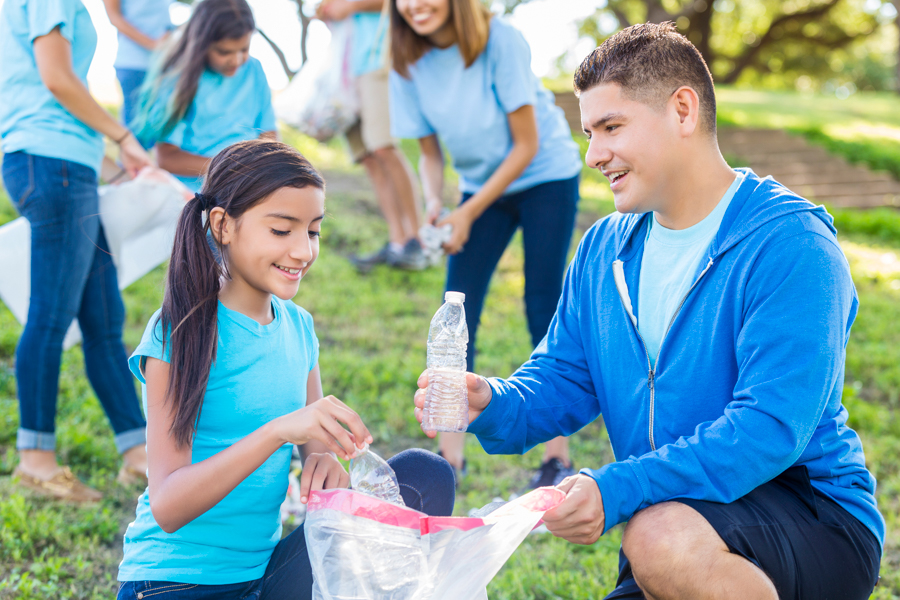 Tw young people cleaning up trash