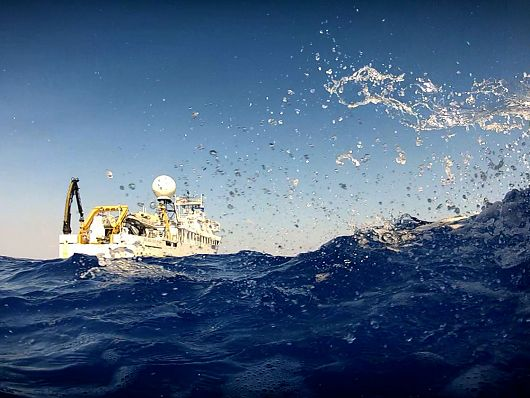 NOAA Ship Okeanos Explorer sitting in the ocean with waves splashing - popup