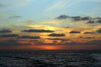 Sunset with clouds over the water - thumbnail