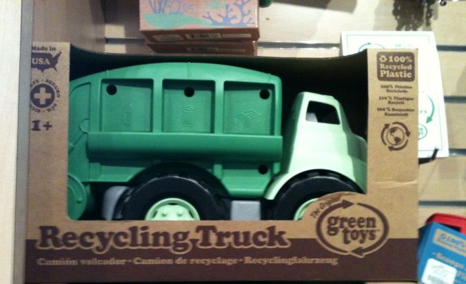 Green toy truck in gift store - lightbox