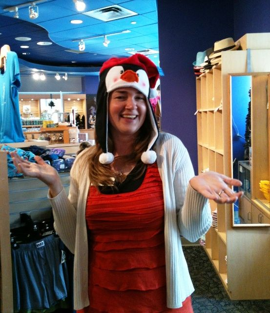Claire in gift store wearing penguin santa hat