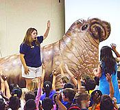 Educator, kids and inflatable animal