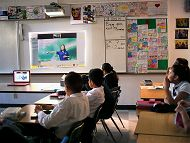 Students in a classroom watching Aquarium led video conference links to Interactive Video Conferencing Programs