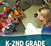 Educator teaching young children with K-2nd grade wording