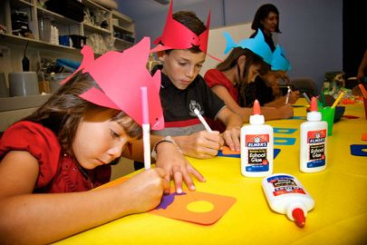 Children doing crafts with paper hats