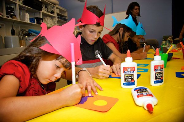 Children doing crafts with paper hats - lightbox