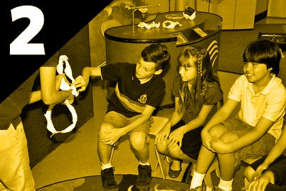Kids exploring shark jaws with educator