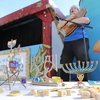 Hanukkah artifacts on a stage - thumbnail