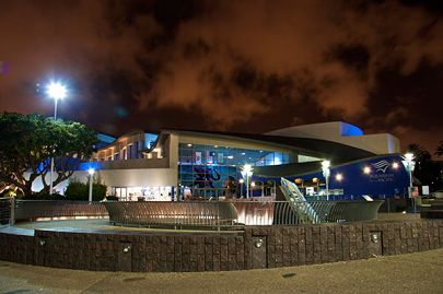 Aquarium exterior at night with red sky