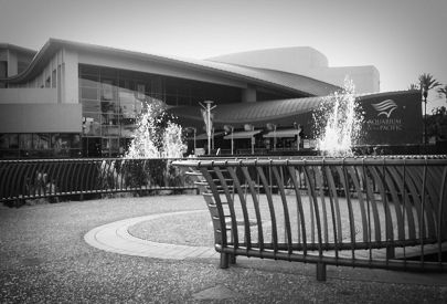 Aquarium exterior by fountain in black and white
