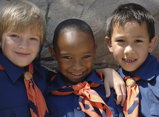 Close-up of three smiling young boys in Cub Scout uniforms - slideshow