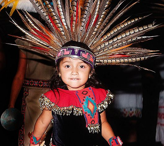 Child wearing traditional Aztec headdress and outfit - popup