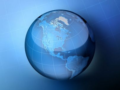 Glass globe against blue background
