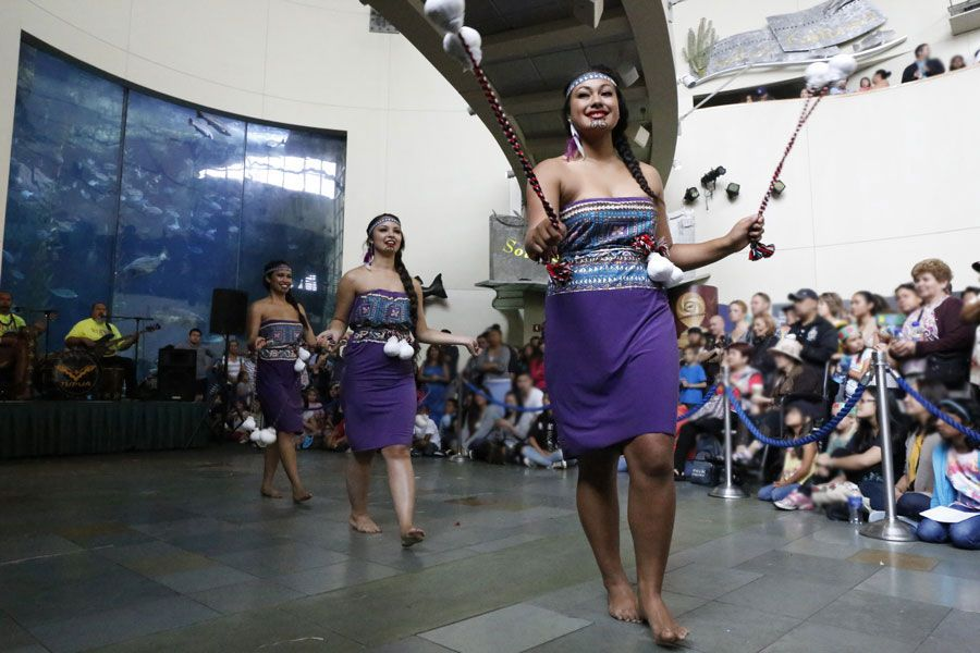 Pacific Islander Festival Performer dances with Poi balls - lightbox