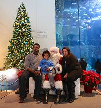 Family photo with Santa Claus in front of Blue Cavern - thumbnail