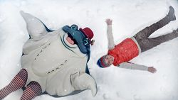 Ray mascot and boy make snow angels