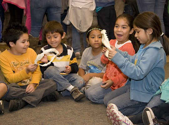 happy kids playing with two shark jaw bones - slideshow