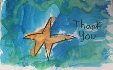 this is an orange sea star on a blue green background, drawn by a child