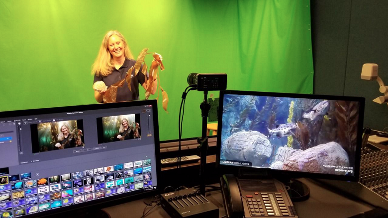 Academy educator in front of a green screen with broadcasting equipment in the foreground - popup