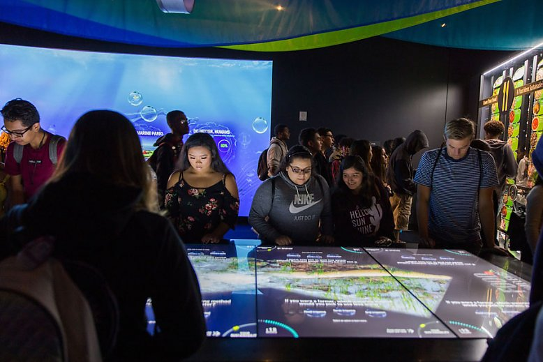 Visitors explore interactive exhibits - slideshow