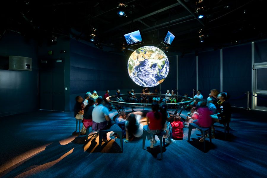 Ocean Science Center interior with people around globe - lightbox