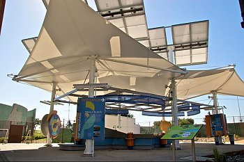 Watershed exhibit view with solar panels and canopy popup