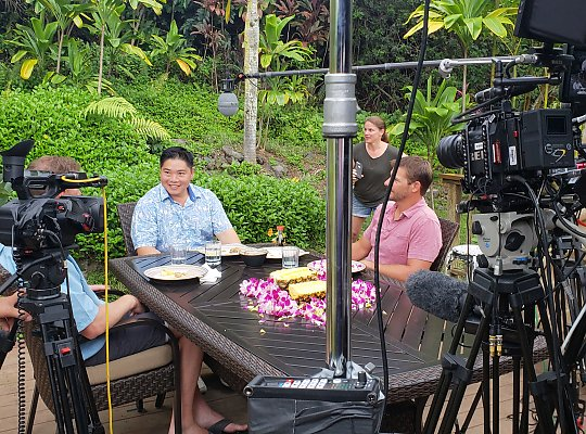 Chef Colin Hazama chats with James Morris and Tyler Korte between takes in Hawaii. - slideshow