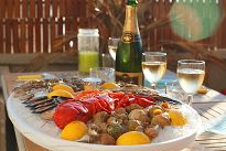 Plate of seafood on ice with champagne glasses