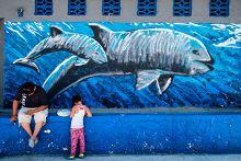 Vaquita mural with people in front links to Gallery of San Felipe and Vaquita Conservation