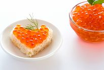 Orange caviar plated in the shape of a heart