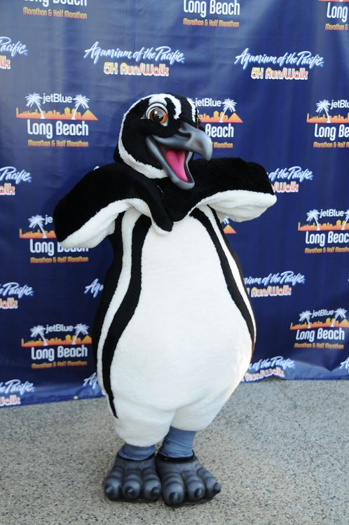 Penguin mascot posing in front of 5k step and repeat - lightbox