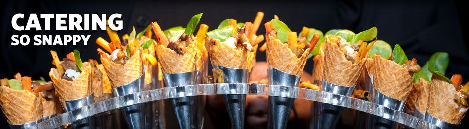 row of appetizers in cones - banner