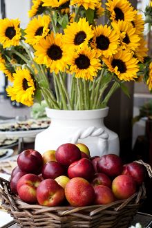 sunflowers with a basket of apples