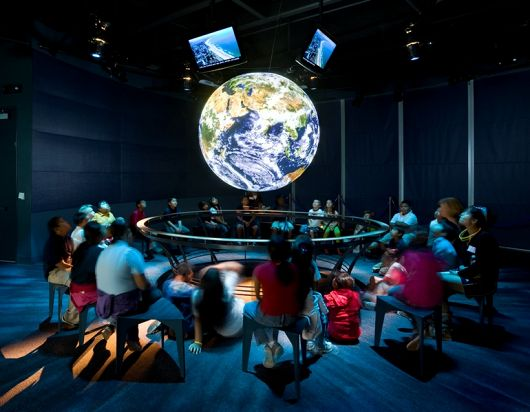 Guests surround globe Science on a Sphere - popup