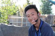 Young male volunteer smiling with a microphone