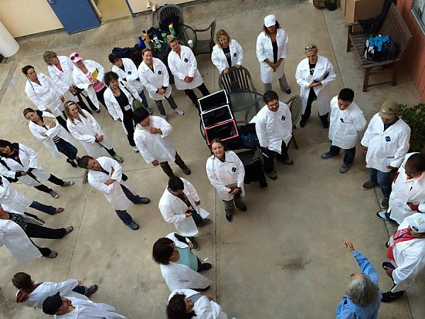 People in lab coats in a circle