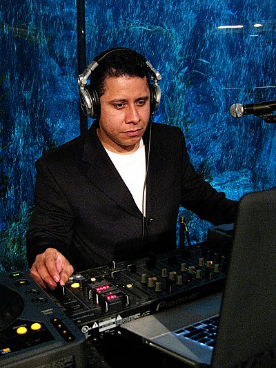 DJ Quinto Sol playing music in front of Aquarium exhibit - thumbnail