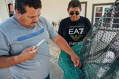 Fishermen fixing a Turtle Excluder Device - thumbnail