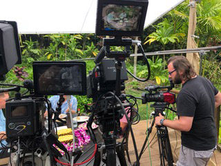 Camera operator Jack Lawson makes some adjustments on the set of the Hawaii table discussion.