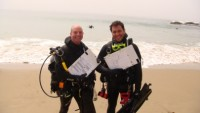 scientific divers on a beach